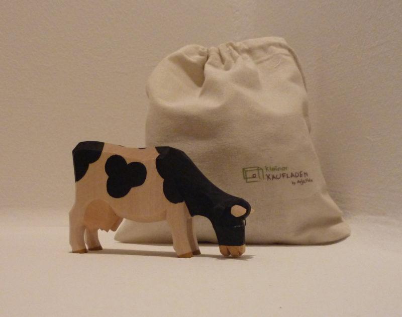 Kuh schwarz fressend von Lotte Sievers-Hahn